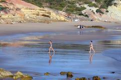 Teen girls running at beach Stock Photo