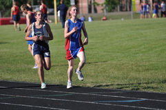 Teen Girls Running in Track Meet Race Stock Images