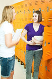 Teen Girls in School Hallway Stock Photos