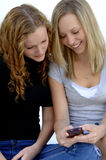 Teen girls sending text message stock photography