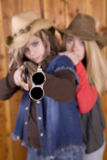 Teen girls with shotgun. Two country girls with a shot gun looking serious Stock Photos