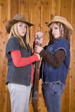 Teen girls with shotgun. Two country girls with a shot gun looking surprised Royalty Free Stock Photo