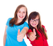 Teen girls showing thumbs up Stock Photography