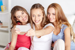 Teen girls with smartphone taking selfie at home Royalty Free Stock Photos