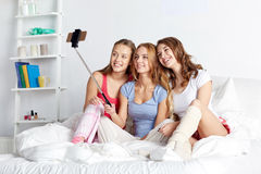 Teen girls with smartphone taking selfie at home Royalty Free Stock Photography