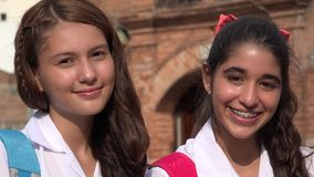 Teen Girls Smiling Teens. A group of young hispanic female teens Royalty Free Stock Images