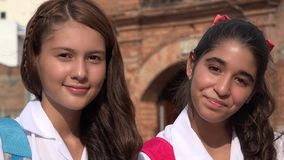 Teen Girls Smiling Teens. A group of young hispanic female teens Stock Image