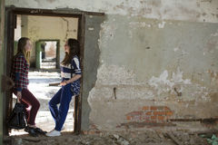 Teen girls standing in the aisle in an abandoned building. Tryst. Stock Images