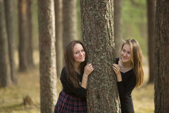 Teen girls standing in a forest near the tree. Nature. Royalty Free Stock Photo