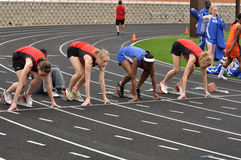 Teen Girls in Starting Blocks at High School Race