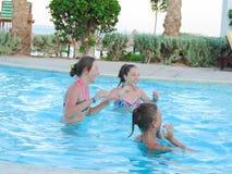 Teen Girls at Swimming Pool. Egypt, Nov. 23 2014 : Happy people and girls in bikini enjoying bath time in pool, Sharm el-Sheikh Royalty Free Stock Photography