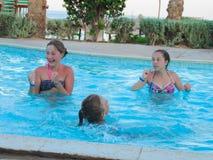 Teen Girls at Swimming Pool. Egypt, Nov. 23 2014 : Happy people and girls in bikini enjoying bath time in pool, Sharm el-Sheikh Royalty Free Stock Image