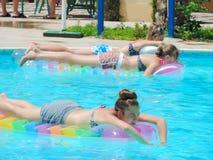 Teen Girls at Swimming Pool. Egypt, Nov. 23 2014 : Happy people and girls in bikini enjoying bath time in pool, Sharm el-Sheikh Royalty Free Stock Photos