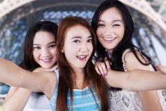 Teen girls taking photo in Paris Stock Photos