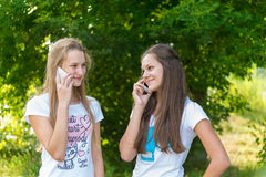 Teen girls talking on cell phone Stock Photo