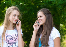 Teen girls talking on cell phone Stock Images