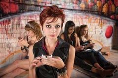 Teen Girls Texting Stock Photo