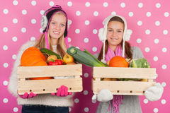 Teen girls with vegetables in winter Stock Images