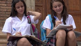 Teen Girls Writing At School Royalty Free Stock Photos