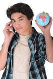 Teen with a globe Stock Photos