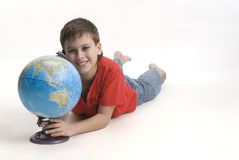 Teen with a globe Royalty Free Stock Photos