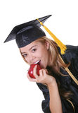 Teen graduate eating apple Royalty Free Stock Photo