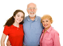 Teen with Grandparents. Teen girl and her senior grandparents.  Isolated on white Royalty Free Stock Photo