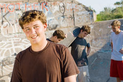 Teen group. Group of young teen skateboard boys skateboarding outdoors Stock Image