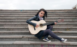 Teen with guitar royalty free stock images