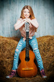 Teen with guitar Royalty Free Stock Photo