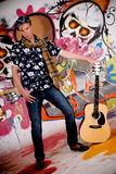 Teen guitar graffiti wall Stock Image