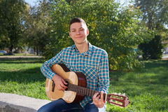 Teen with guitar Stock Image