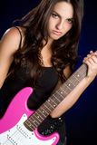 Teen Guitar Player. Teen electric guitar player girl royalty free stock image