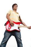 Teen guitarist isolated. Portrait of male teen guitarist playing with attitude - isolated Royalty Free Stock Photography
