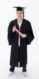 Teen Guy Celebrating Graduation. Agaisnt white background Royalty Free Stock Image