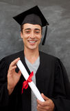 Teen Guy Celebrating Graduation in the class Stock Images