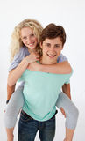 Teen guy giving a friend piggyback ride Stock Image