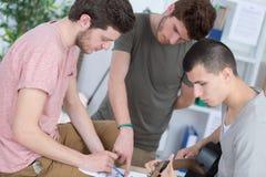 Teen guys composing music at home stock photos