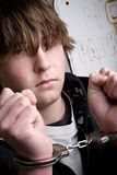 Teen in handcuffs - crime. Teen in handcuffs under arrest royalty free stock photo
