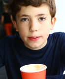 Teen handsome boy with cappuccino cofe paper Royalty Free Stock Images