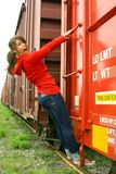 Teen hanging from train Stock Image