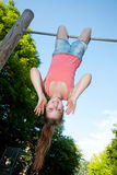 Teen hanging upside down Royalty Free Stock Image