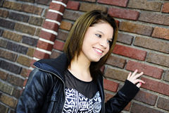 Teen Happily Waiting by a Wall Royalty Free Stock Photos