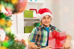 Teen happy boy with Christmas presents Stock Image