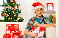 Teen happy young boy with New year presents Stock Photography