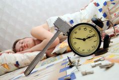 Teen has broken an alarm clock and sleep Stock Photography