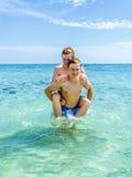 Teen have fun playing piggyback Royalty Free Stock Photo