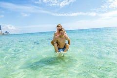 Teen have fun playing piggyback Royalty Free Stock Photos