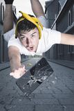 Teen have stumbling on banana peel and flying after shattered smart phone which falling to street royalty free stock images