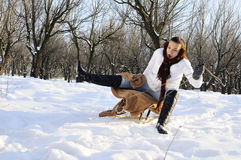 Teen having accident with sledge. White girl having accident with sledge in winter season Royalty Free Stock Photos